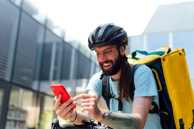 Portrait of food delivery man with mobile phone