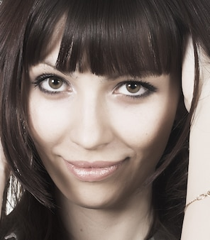 Portrait of fresh and beautiful brunette woman on white
