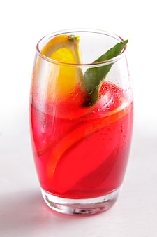 Portrait of fresh fruit punch with orange slice for refreshment