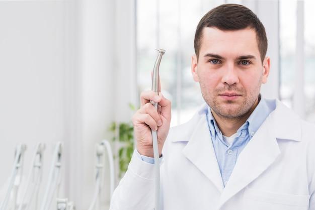 Portrait of friendly dentist