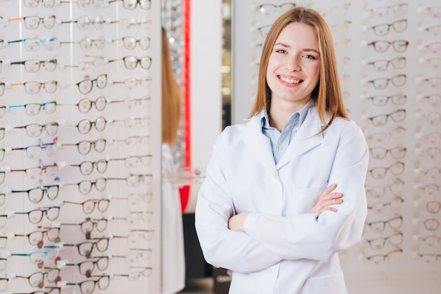 Portrait of friendly female optometrist
