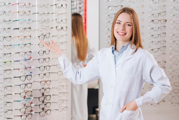 Portrait of friendly female optometrist