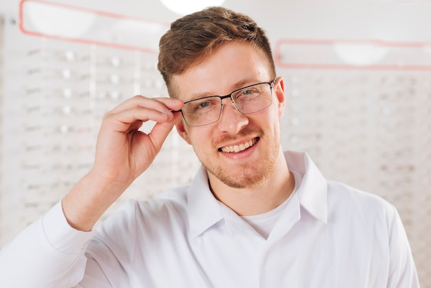 Portrait of friendly male optometrist