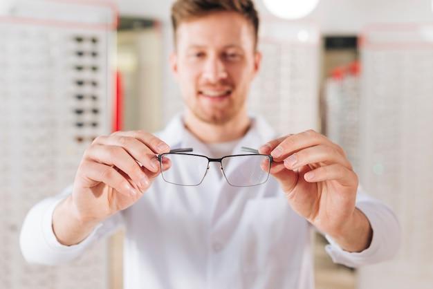Portrait of friendly male optometrist