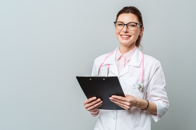 Portrait of a friendly smiling young female doctor image of a female doctor with glasses and with a