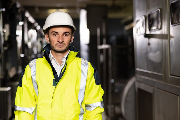 Portrait of a frontline essential worker in a warehouse caucasian business people in hard hat