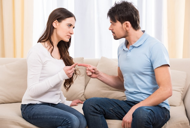 Portrait of frustrated couple are reling with each other.