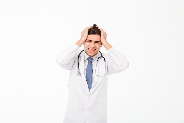Portrait of a frustrated young male doctor man