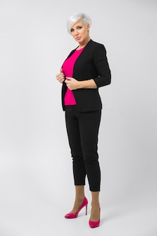 Portrait of a full-length stylish young woman isolated