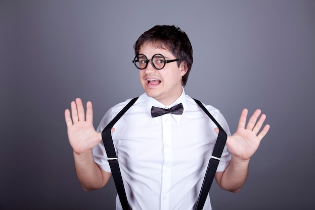Portrait of funny fashion men in suspender with bow tie and glasses.