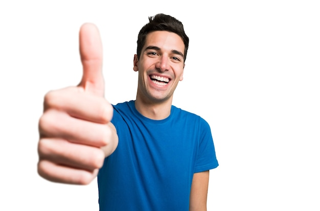 Portrait of a funny man giving thumbs up