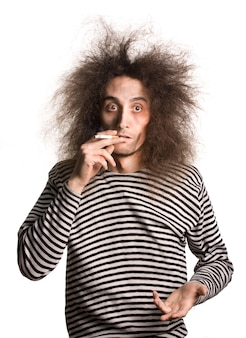 Portrait of funny young man after electric shock with high voltage