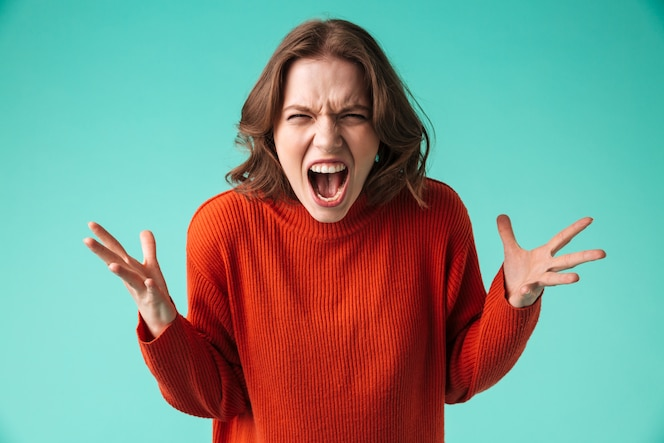 Portrait of a furious young woman dressed in sweater