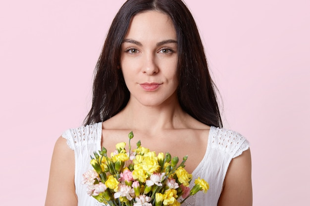 Portrait of gentle brunette young lady