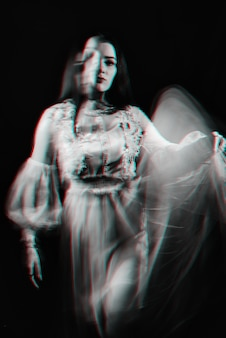 Portrait of a ghost girl in a dress. black and white anaglyph with 3d virtual reality glitch effect