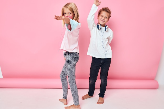 Portrait of a girl and a boy entertainment headphones playing childhood lifestyle concept
