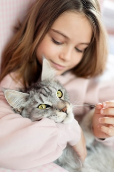 Portrait of girl and cat