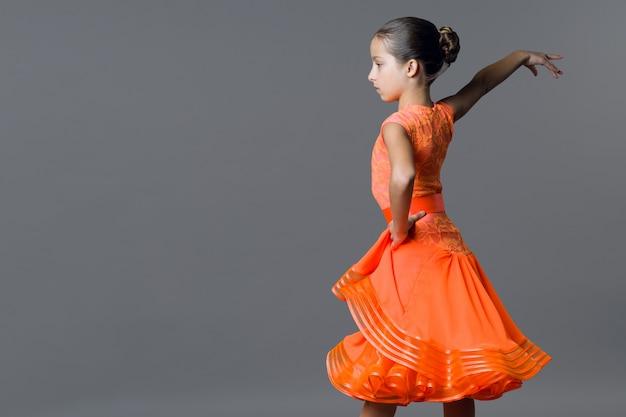 Portrait of a girl child dancer. sports ballroom dancing, latino.