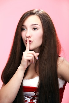 Portrait of a girl doing a silence gesture