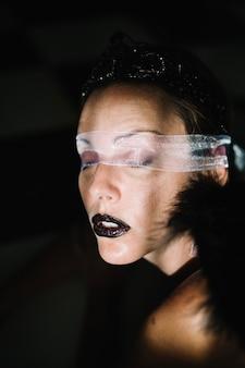 Portrait of girl in eye bondage