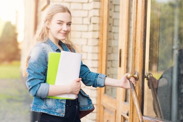 Portrait of girl in front of school