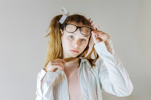 Portrait of a girl holding eyeglasses