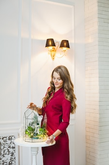 Portrait of a girl in the interior, florariums in the interior, interior solutions, business and home