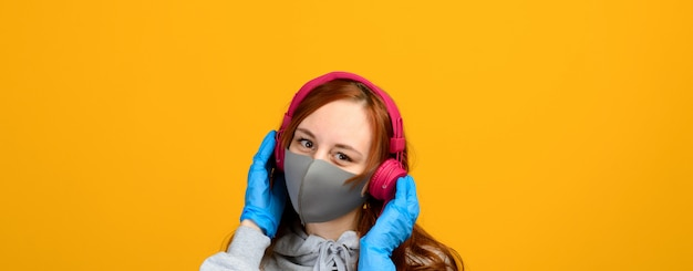 Portrait of a girl in a mask, which puts on a rubber glove.