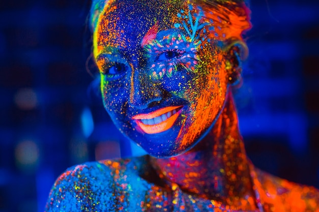 Portrait of a girl painted in fluorescent powder.