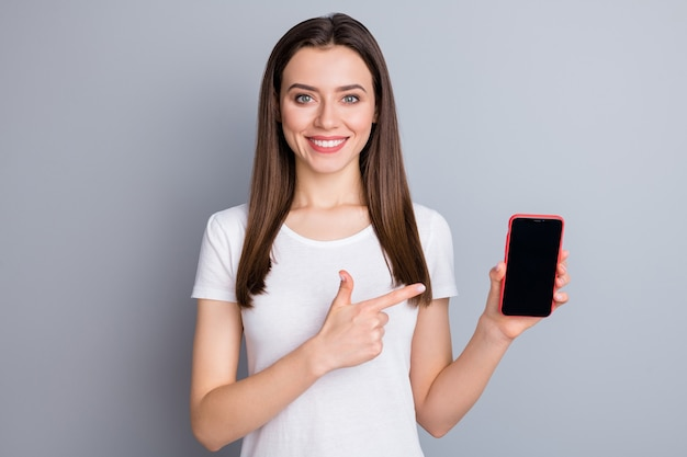 Portrait of girl promoter point index finger smartphone demonstrate touchscreen