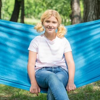 Portrait girl sitting in hammock