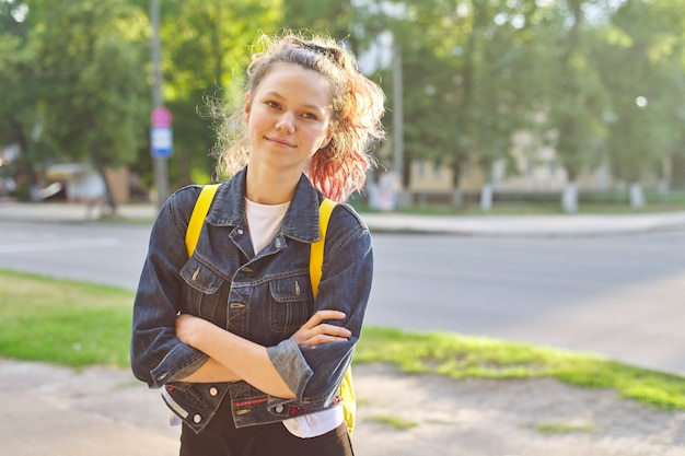 Portrait of girl student 15 years old with backpack