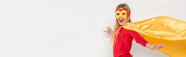 Portrait girl wearing hero costume
