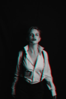Portrait of a girl in a white shirt with suspenders and red lipstick. photo with the thrown grain. black and white with 3d glitch virtual reality effect