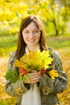 Portrait of girl with autumn bouquet