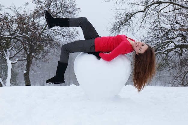 Portrait of a girl with a big snowy heart