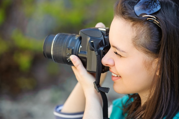 Portrait of girl with camera