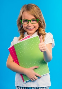 Portrait of a girl with glasses isolated