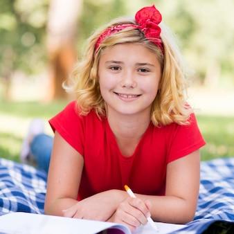 Portrait girl writing