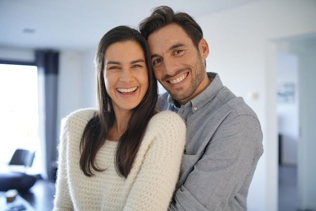 Portrait of gorgeous couple embracing at home