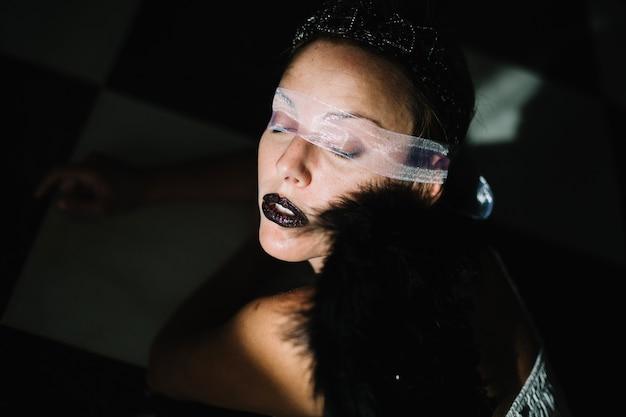 Portrait of gothic woman with eye bondage