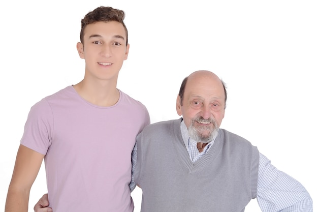 Portrait of grandfather and his teen grandson smiling
