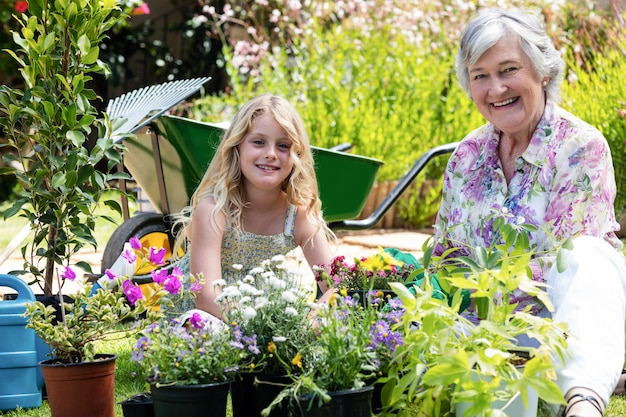 Portrait of grandmother and granddaughter gardening together
