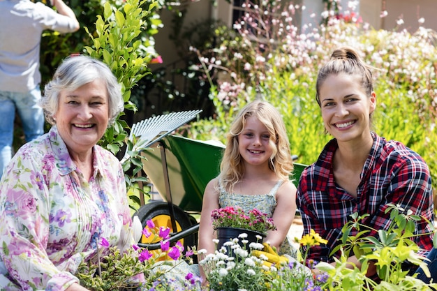 Portrait of grandmother, mother and daughter gardening together