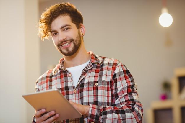 Portrait of graphic designer using digital tablet