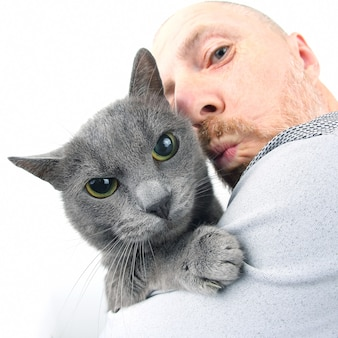 Portrait of a grey cat with a man