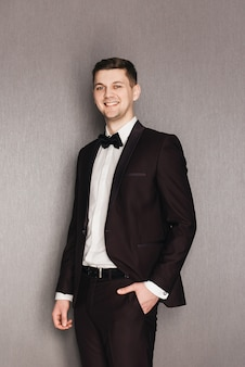 Portrait of a groom wearing a suit