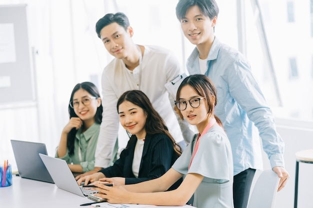 Portrait of group asian bussiness people working at office