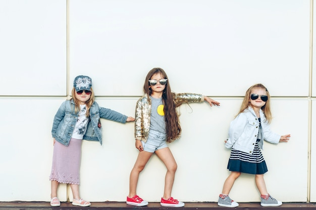 Portrait of a group of beautiful little girls posing outside