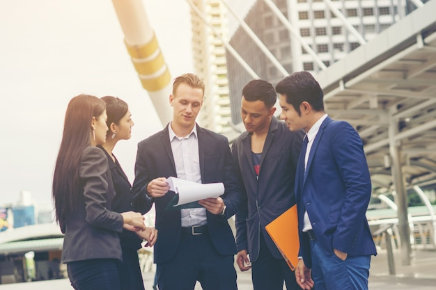 Portrait group of business people conversation at meeting outside. business concept.